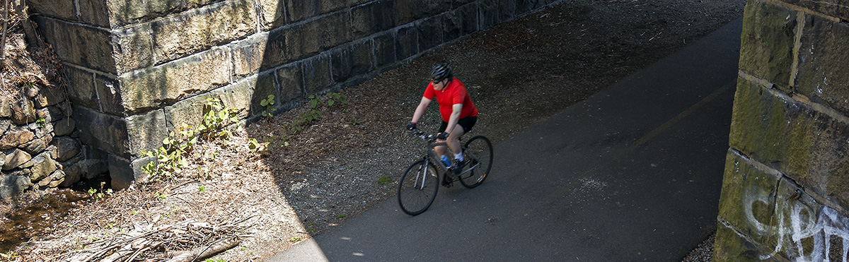 Man riding on Minuteman Bikeway